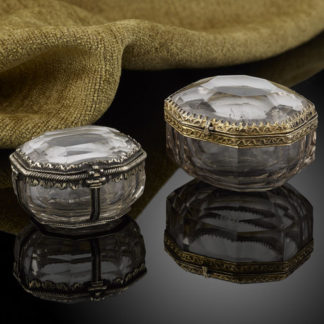 Two little rock crystal boxes with silver gilt mounts